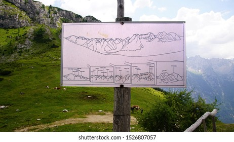 DOLOMITES, ITALY - AUG 3, 2018 - Dolomite Alps map on trail in the Dolomite Alps near Toblach, Italy