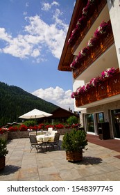 DOLOMITES, ITALY - AUG 4, 2018 - Alpine hotel in the Val Gardena, Selva - Wolkenstein, Italy