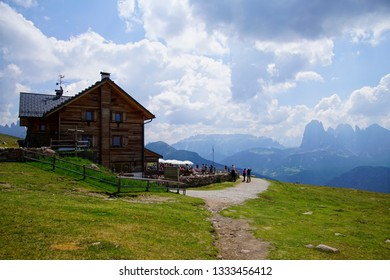 DOLOMITES, ITALY - AUG 5, 2018 - Hikers break for lunch at an alpine hut in the Dolomites Alps, Italy