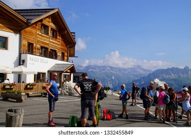 DOLOMITES, ITALY - AUG 6, 2018 - Hikers prepare in parking lot of a mountain hut  I the Dolomites Alps, Italy