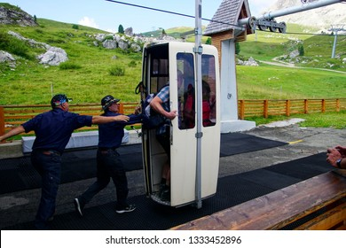 DOLOMITES, ITALY - AUG 6, 2018 - Loading the 'coffin' skilift in the Dolomites Alps, Italy