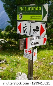 DOLOMITES, ITALY - AUG 7, 2018 - Hiking signs for baby carriage in the Dolomites Alps, Italy