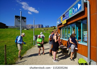 DOLOMITES, ITALY - JUL 24, 2018 - Hikers use the summer skilift chair to begin their walk in the Dolomites Alps, Italy