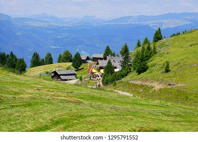 DOLOMITES, ITALY - JUL 24, 2018 - Hikers visit a mountain hut before continuing their walk in the Dolomites Alps, Italy