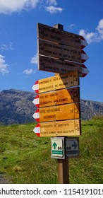 DOLOMITES, ITALY - JUL 25, 2018 - Sign post for trails on a meadow of the Seiser Alm of the Dolomites Alps, Italy