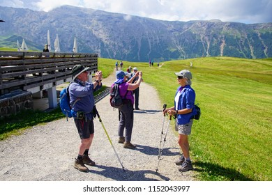 DOLOMITES, ITALY - JUL 27, 2018 - Hikers taking pictures in the Schlern area of the  Dolomites Alps, Italy