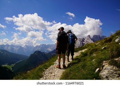DOLOMITES, ITALY - JUL 29, 2018 - Hikers on steep trail up Monte piana, Dolomites Alps, Italy