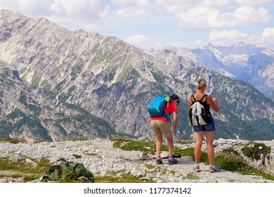 DOLOMITES, ITALY - JUL 29, 2018 - Hikers photograph the spectacular scenery from Monte piana, Dolomites Alps, Italy