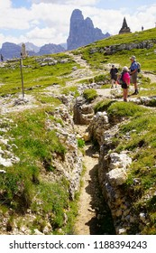 DOLOMITES, ITALY - JUL 29, 2018 - Hikers explore the  World War I trenches in the mountain top of Monte Piana, Dolomites Alps, Italy