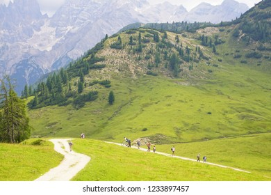 DOLOMITES, ITALY - JUL 29, 2018 - Hikers on the trails of the Seiser Alm meadows of the Dolomites Alps, Italy