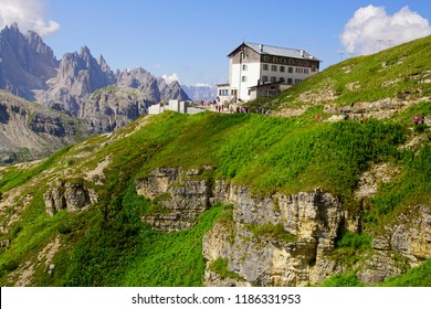 DOLOMITES, ITALY - JUL 31, 2018 - Large group of hikers descend from an alpine hut in the Drei Zinnen area of the  Dolomites Alps, Italy