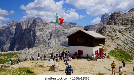 DOLOMITES, ITALY - JUL 31, 2018 - Hikers picnic near the Drei Zinnen hut set among the peaks of the Dolomites Alps, Italy