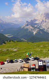 DOLOMITES, ITALY - JUL 31, 2018 - Parking lot fills with hikers in the Drei Zinnen area of the Dolomites Alps, Italy