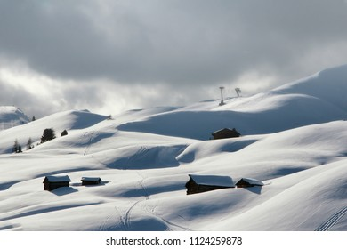 Dolomites, Italy winter landscape at Passo Gardena with majestic Sella mountain group in northwestern Dolomites. Famous travel destination for adventure, trekking, hiking and outdoor activity.
