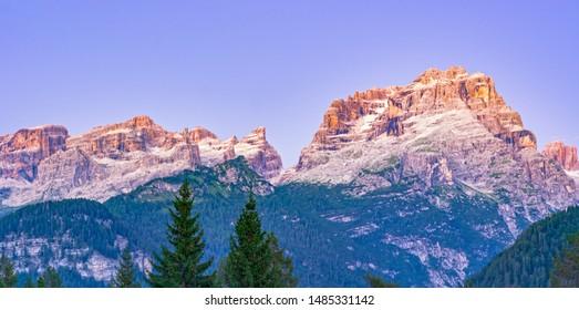 Dolomites mountain range at dusk, Dolomiti di Brenta seen from near Madonna di Campiglio, Trentino, Italy