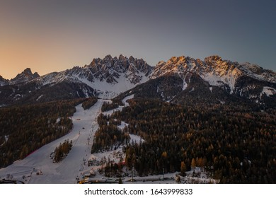 Dolomites Mountain in winter, by San Candido, Alto Adige Italy. Sunrise of ski resort Monte Baranci Haunold. Aerial drone shot in january 2020