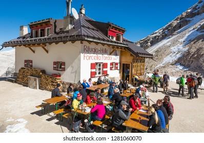 DOLOMITES, Pordoi Pass, Canazei, Italy - September 25, 2016: The mountain hut on the way from Sass Pordoi to Piz Boe, Dolomites,Trentino Alto Adige, northern Italy.