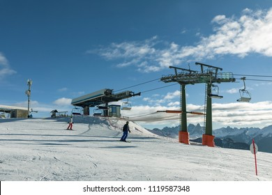 Dolomites, ski area with beautiful slopes.. Empty ski slope in winter on a sunny day. Val di Fiemme-Obereggen. Itaky
