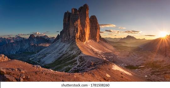 Dolomites, Three Peaks of Lavaredo. Panoramic image of Italian  Dolomites with famous Three Peaks of Lavaredo (Tre Cime di Lavaredo) South Tyrol, Italy, Europe at summer sunset.