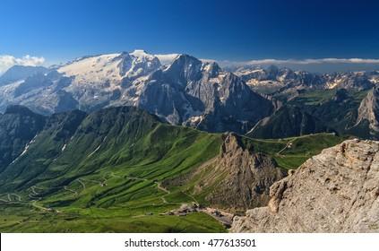 Dolomiti - aerial view of Pordoi pass and Marmolada mount from Sass Pordoi, Trentino, Italy