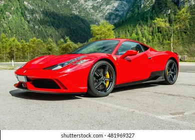 DOLOMITI, Lago di Landro, ITALY - SEPTEMBER 10, 2016:  Red Ferrari 488 GTB  parking on Lago di Landro. The 488GTB is a heavily re-engineered replacement of the Ferrari 458.