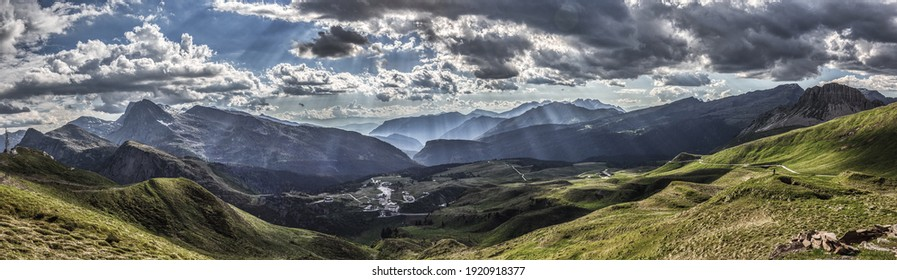 Dolomities in Italy give rise to their cosmic relief, especially under the rays of the sun breaking through the rays and emphasizing the contrasting  relief of mountains and hills