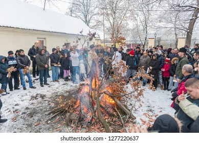 DOLOVO, SERBIA , JANUARY 06 2019 : Christmas eve yule log fire. Orthodox church christmas liturgy