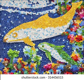 Dolphin mosaic made by plastic bottle caps