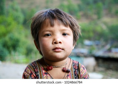 DOLPO, NEPAL - May 21, 2008 : Portrait nepalese cute boy on the street in Himalayan village, Dolpo, Western Nepal.