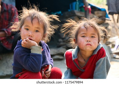 DOLPO, NEPAL - May 21, 2008 : Portrait nepalese girls on the street in Himalayan village, Dolpo, Western Nepal.