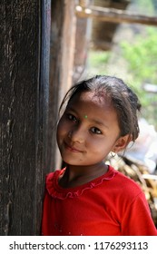 DOLPO, NEPAL - May 21, 2008 : Portrait of smiling nepalese girl on the street in Himalayan village, Dolpo, Western Nepal.