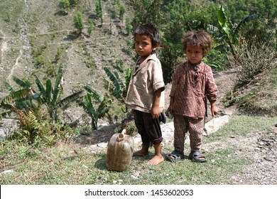 DOLPO, NEPAL - May 21, 2008 : Nepalese girl and boy on the street in Himalayan village, Dolpo, Western Nepal.
