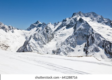Dombai in the spring. A view of the tops of the Caucasian ridge on a sunny day.