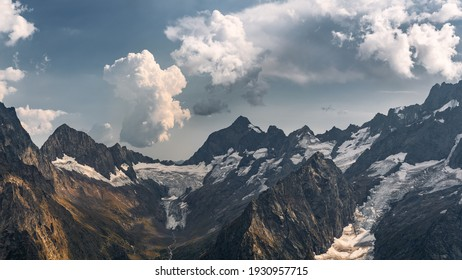 Dombai at sunset. Magnificent panorama of the Caucasus Mountains in high resolution. Wallpaper.