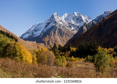Dombay-Ulgen mountain and valley at atumn in Dombay, Russia