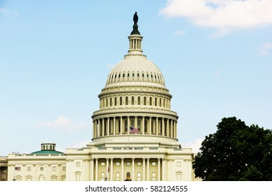 Dome of Capitol Building with clouds and blue sky on the background in Washington DC, United States. Power, legislation, congress, concept