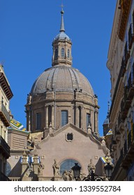 The dome of The Cathedral-Basilica of Our Lady of the Pillar as viewed from calle Alfonso I in Zaragoza, Spain