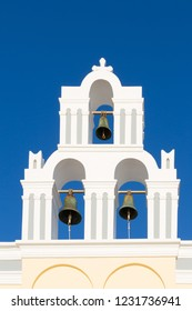 Dome of a church with bells on Santorini island. Cyclades of Greece.