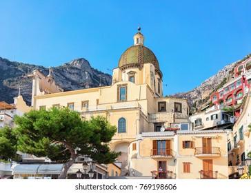 Dome of the Church of Santa Maria Assunta at Positano town in autumn, Amalfi coast, Italy