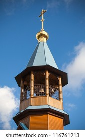 Dome with cross of small wooden Orthodox church in St.Petersburg, Russia