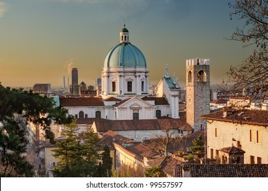 the dome of the Duomo Nuovo cathedral, old palaces and modern buildings in Brescia immediately after sunrise