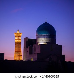 The dome of the Kalyan mosque and the Kalyan minaret in Bukhara in the early morning. They make up the architectural ensemble of the Poi Kalyan, located at the foot of the Kalyan minaret.