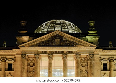 The dome on the roof of the Reichstag in Berlin, Germany at night.