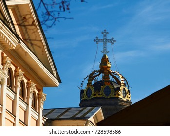 dome of the Orthodox Church in the form of a crown with a fragment of an old manor in the foreground