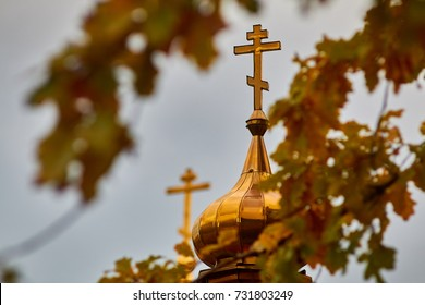 dome of the Orthodox Church through the autumn foliage