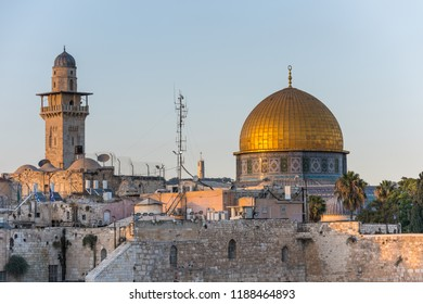 The Dome of the Rock, or called Qubbat al-Sakhra,  and minaret under sunset,  an Islamic shrine located on the Temple Mount in the Old City of Jerusalem.