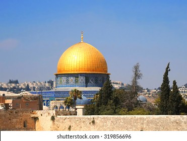 Dome of the Rock Mosque and Dome of the Chain on the Temple Mount behind the Western Wall in Jerusalem, Israel in a clear sky