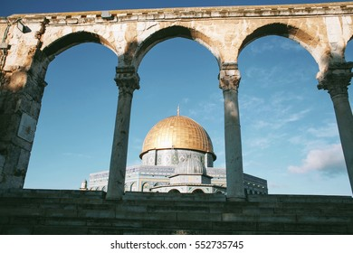 Dome of the Rock and an old arch in Jerusalem, Israel
