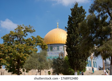 The Dome of the Rock on the Temple Mount in Jerusalem, Israel. Exterior view of the Dome of the Rock or Al Qubbat as-Sakhrah in Arabic.Blue sky at Dome of the Rock Jerusalem
