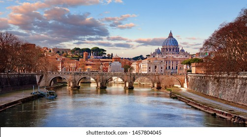 Dome Saint Peters Basilica Vatican City. Cityscape Panoramic. View Old bridge evening sunset with sky and pink clouds. Autumn landscape.